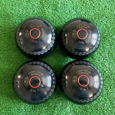 Set of Thomas Taylor Lignoid Lawn Bowls, size 1