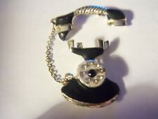 VINTAGE BLACK AND GOLD ENAMEL TELEPHONE BROOCH WITH A RHINESTONE DIAL...