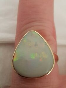 18ct Yellow gold dress ring.Of modernists design. Set with an Opal