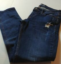 Levis 524 5 pocket skinny jeans medium wash distressed legs and pockets