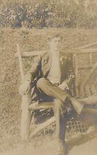 Man Sitting on Rustic Bench Real Photo Postcard rppc