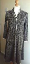 Vintage black/white spotty long sleeved dress 70s. We have more vintage clothing