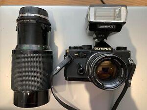 Olympus OM-2 bundle. Zuiko f 50 lens + Vivitar macro auto zoom 70-210. T20 flash