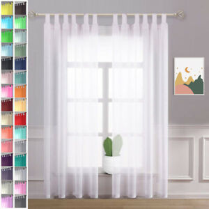A pair of high quality Voile Curtain 2 Panels 10cm long tab Top solid sheer