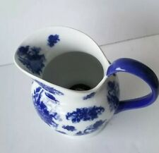 Blue and white ceramic pitcher with lotus like flowers blue handle large