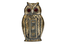 A vintage brass owl paperweight Red eyes