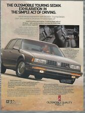 1988 OLDSMOBILE TOURING SEDAN advertisement, Olds ad, silver sedan