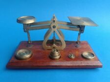 VINTAGE ENGLISH POSTAL WEIGHTS BRASS AND WOOD - AND 7 BRASS WEIGHTS