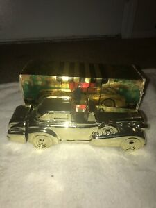 AVON 1969  SOLID  GOLD  CADILLAC  CAR  DECANTER  EMPTY BOTTLE (pre owned)