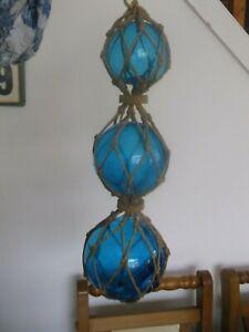 Vintage glass fishing floats in string net