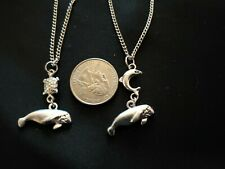 2 Silver Tone Manatee, Sea Turtle and Dolphin necklaces