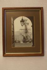 "A FRAMED FRANK MEADOW SUTCLIFFE PRINT ""THROUGH THE STATION DOORWAY"""