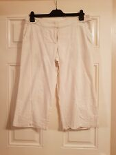 Cropped cream linen trousers