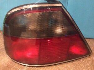 Jaguar Daimler X300 left ; nearside rear light. chrome surround