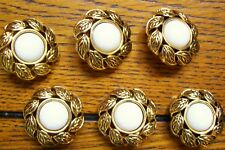 6 white cabochon style buttons in a gilded leaf frame 26 mm. diameter