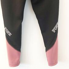 Reversible Pink Victoria's Secret Leggings with stripes of mesh on the legs. L