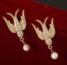 Cristalli color oro rondine uccello con un pendenti orecchini con perla a lobo