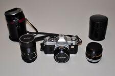 kit CANON AT-1 con FD 50/1,8 e 28 mm Canon FD e Vivitar 135 mm borse e filtri