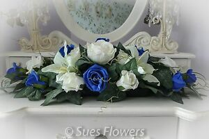 Top Table Centre Piece in royal blue and ivory church flowers  venue deco ect.