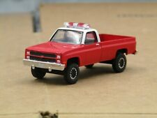 dcp/greenlight CUSTOM lifted 1981 Chevy square body red/white p/up truck 1/64.