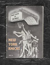 1956 - 57 NEW YORK KNICKS MEDIA GUIDE SIGNED - GUERIN, CLIFTON, McGUIRE