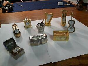 Lot of 9, Miniature Brass Quartz Clocks. Bulova, Linden. Nice clean Lot