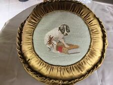 victorian needlework pillow with scared dog and bug