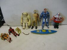 7 Assorted Action Figures with He-Man, Centurions, Star Wars