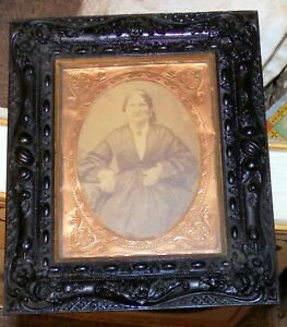 Old gutta percha picture frame with a cabinet photo.no reserve