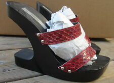 SKY- pre-owned. Size 7. Abstract wooden heel w/ burgundy leather snake skin