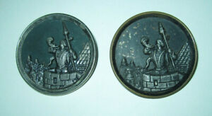 Lot of two large antique brass picture buttons, sentry in castle turret w horn