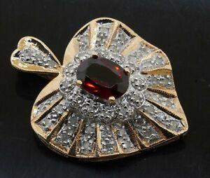 14K 2-tone gold 1.71CTW diamond cluster & 8 X 6mm Oval garnet heart pendant