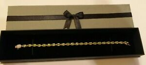 9ct gold peridot set Tennis bracelet with diamond chip clasp 5.5 gms
