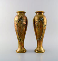 A pair of French art nouveau bronze vases with flowers in relief. Ca. 1890