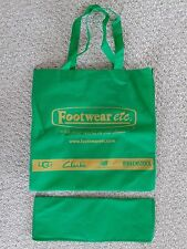 green canvas reusable bag, Footwear etc with shoe brand names