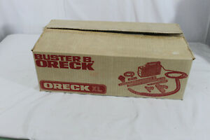 ORECK XL BUSTER B VACUUM CLEANER w/ attachments new open box. in original box.