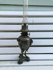 ANCIENNE LAMPE A PETROLE EN EN METAL ARGENTE TETE DE BELIER