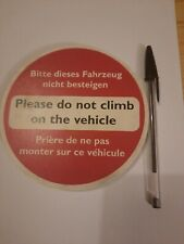 """Its a sign.""""Do not climb on the vehicle"""" in French and German as well. See photo"""