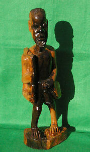 LARGE CARVING OF A BEARDED AFRICAN MAN WALKING IN TWO TONE HARDWOOD