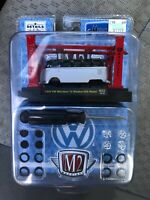 M2 machines vw microbus 15 window. silver with black top.