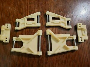 Vintage rc10 team car front and rear suspension arms, hinge pins and rear mounts