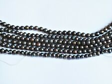 Freshwater pearl iridescent brown beads 5mm.