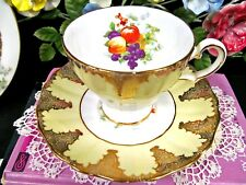 GROSVENOR tea cup and saucer yellow gold gilt pattern orchard fruits teacup