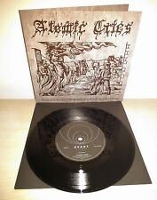 "7"" ATOMIC CRIES - SUSPENDED BETWEEN THE MOUTH OF GOD AND THE FIST OF MAN"