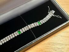 White gold finish created diamond and emerald triple row tennis bracelet giftbox