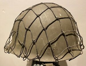 WWII original US Army M1 Helmet wide hole camouflage net. Lightly used