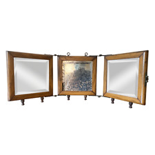Antique Victorian Tri-fold Travel Mirror with beveled edges hanging
