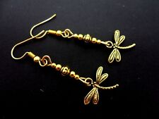 A PAIR OF PRETTY LITTLE GOLD COLOUR DANGLY DRAGONFLY THEMED  EARRINGS. NEW.