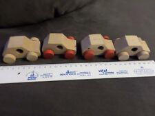 Holzspielzeug, 4 Autos ca. 7 cm lang.