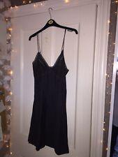 AllSaints Olivia slip. Black adjustable. size 10.